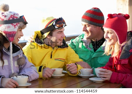 Teenage Family Enjoying Hot Drink In Cafe At Ski Resort #114544459