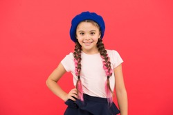 Teenage fashion. French fashion attribute. Child small girl happy smiling baby. Kid little cute fashion girl posing with long braids and hat red background. Fashion girl. Fashionable beret accessory.