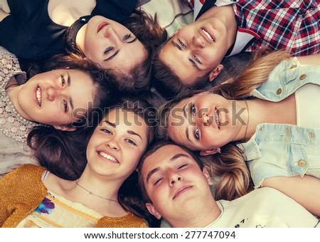 Teenage friends lying together in circle #277747094