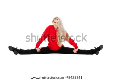 Teenage girl acrobatics gymnastic doing twine exercise, wearing red and black sportswear clothing, studio series, isolated over white background.