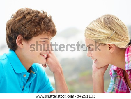 Teenage girl and boy head and shoulders in profile