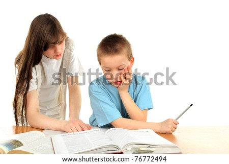 teenage girl and schoolboy on the table with exercise books