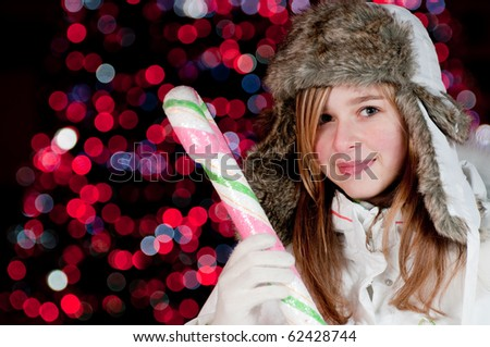 Teenage girl at Christmas - Defocused Christmas Tree Lights