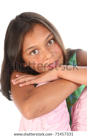Teenage girl beautiful brown eyes leaning on knees