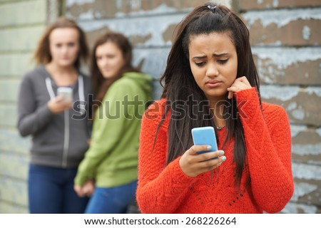 Teenage Girl Being Bullied By Text Message Stock photo ©
