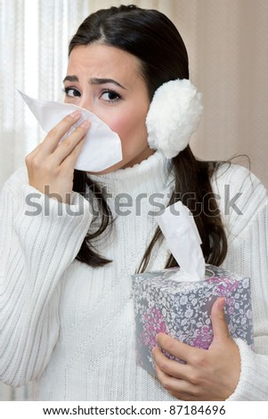 Teenage Girl blowing her nose with Handkerchief.