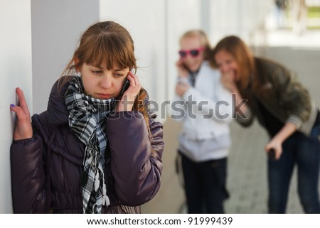 Teenage girl calling on the phone - stock photo