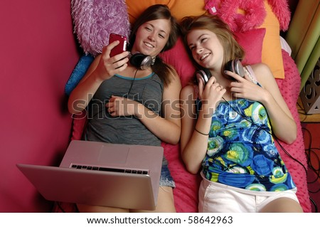 Teenage girl checks her text messages on her mobile phone.