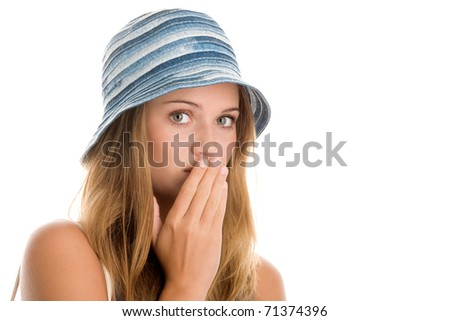 Teenage girl covering mouth with hand