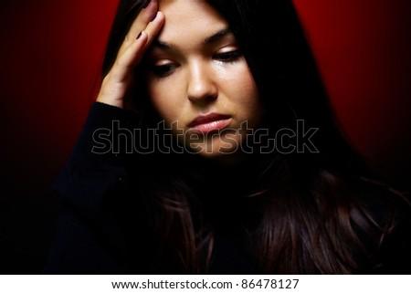 Teenage girl crying in the dark