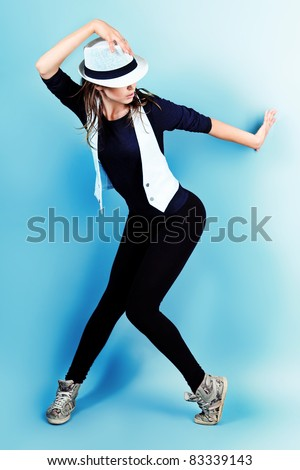 Teenage girl dancing hip-hop at studio.