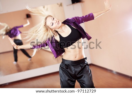 Teenage girl dancing hip-hop in gym classroom
