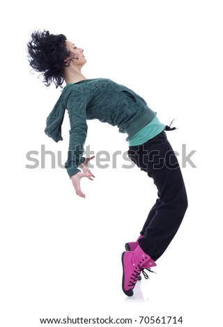 Teenage girl dancing hip-hop leaning on back, over white