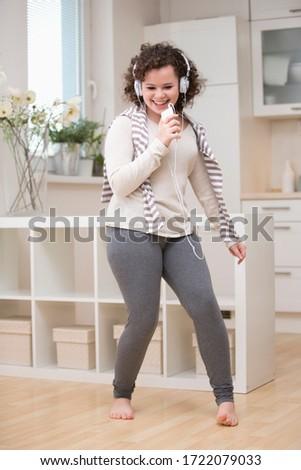 Teenage girl dancing to mp3 player