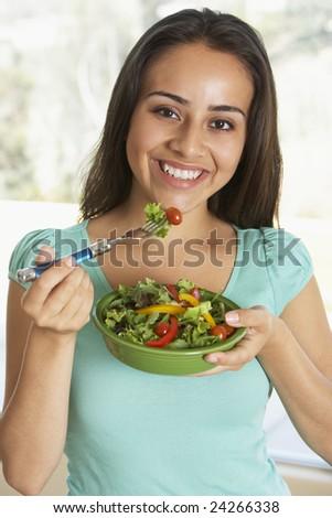 Teenage Girl Eating A Salad - stock photo
