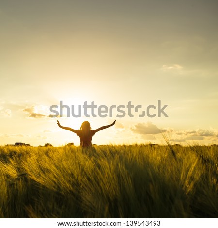 Teenage Girl Enjoy With Sun In The Evening Glow