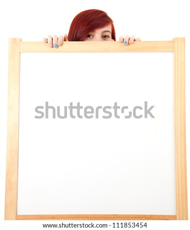 teenage girl hiding behind blank placard, white background