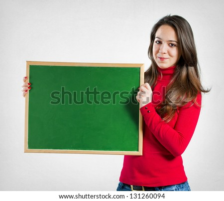 Teenage girl holding a blackboard