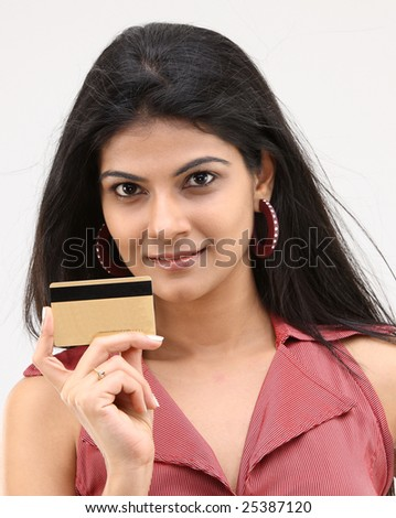 teenage girl holding credit card