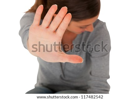 teenage girl  holding hand up to block violence