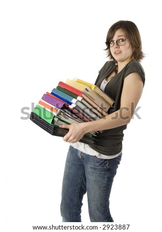 teenage girl holding large stack of books