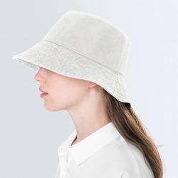 Teenage girl in beige bucket hat for street fashion shoot