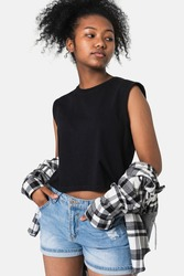 Teenage girl in black top and flannel shirt for youth apparel grunge fashion shoot