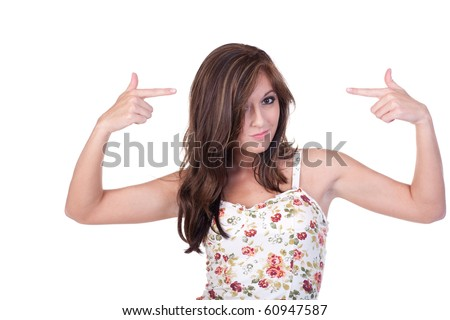 Teenage girl in blue jeans and flower print top, pointing at herself with both hands.