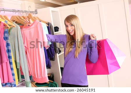 stock photo : Teenage girl in clothing store. Save to a lightbox ▼