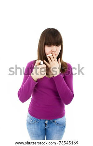 Teenage girl lighting cigarette isolated on white