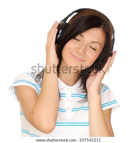 Teenage girl listen the music. Isolated on white background