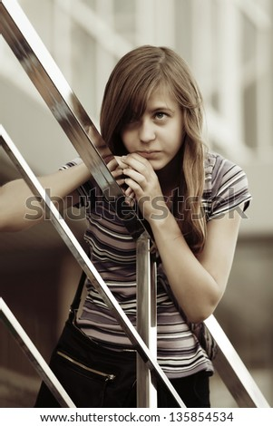 Teenage girl looking away - stock photo
