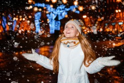 teenage girl on a festive evening on the street in winter
