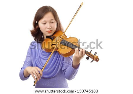 Teenage girl playing the violin isolated on white background