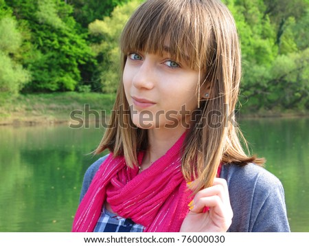 Teenage girl portrait by the river