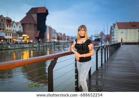 Teenage girl portrait in the old town of Gdansk at dusk, Poland #688652254