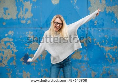 Teenage girl posing and having fun, party life, wearing glasses #787643908