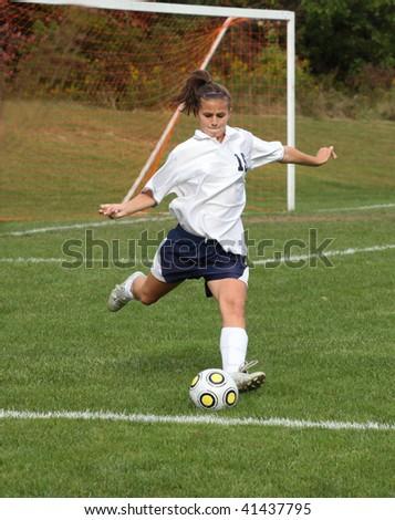 Teenage Girl Ready to Kick Soccer Ball