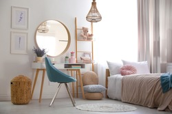 Teenage girl's bedroom interior with stylish furniture. Idea for design