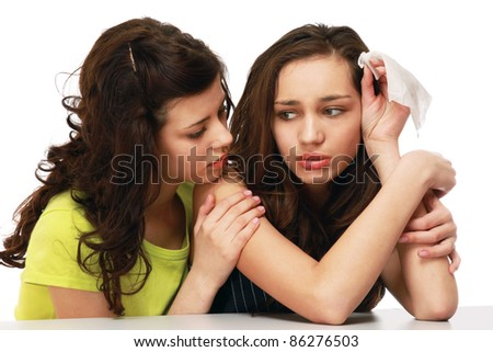 Teenage girl supporting her friend or sister isolated on white