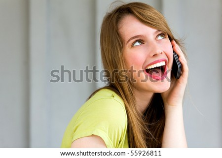 Teenage girl talking on a mobile phone