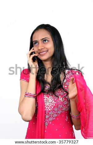 Teenage girl talking on phone. Isolated on white.