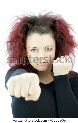 teenage girl throwing punch with fist