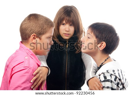 Teenage girl trying to separate two angry teenage boys that want to start the fight.