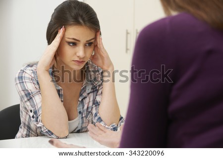 Teenage Girl Visiting Counsellor To Treat Depression