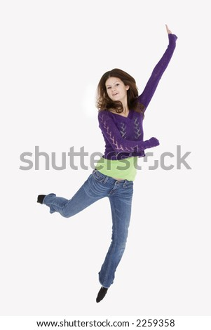Teenage girl who is jumping very excited