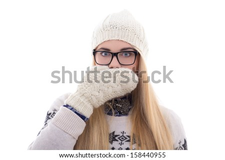 teenage girl with beautiful long hair in warm winter clothes closing her mouth isolated on white background