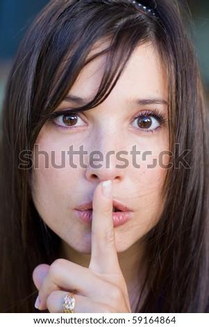 teenage girl with finger on lips