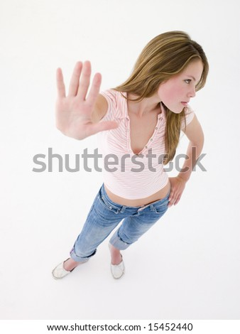 Teenage girl with hand up