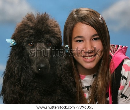 Teenage girl with standard poodle